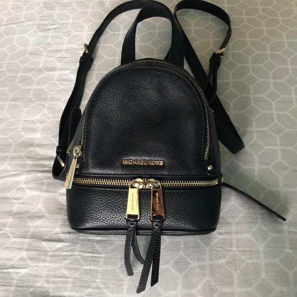 f05a9c81fe34 Michael Kors Mini rhea backpack. M_5ab547c4caab44e384f840b2